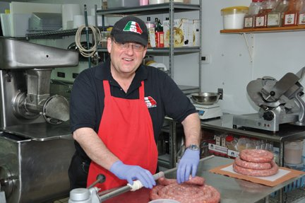 Michael Gerome with sausage