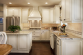 Antique white and brown kitchen with vintage style granite countertops